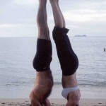 Dana Rae Paré in Sirsasana with Trevor Monk in Koh Samui, Thailand