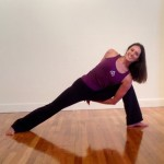 Infinite Yoga Teacher Lauren Hayden in parsvakonasana variation